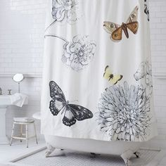 What goes with a bathroom with vintage 1930s 'goldenrod' tiles? Maybe this butterfly shower curtain from West Elm?