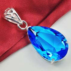 Pendant measurements: Total length: 1.89″, total width: 0.75″, total thickness: 0.51″ Gemstone measurements(L*W): 1.13*0.71″ Pendant features: Pear faceted gemstone pendant is in three prong setting with high polish finish. The gemstone is blue Pendant NET Weight: 0.32 oz Chain: crossed-chain, plated silver, lobster claw clasp connection, approx. length: 18″
