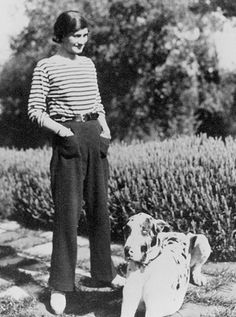 Coco Chanel with her Great Dane, what I love about her is that this would be in style today!