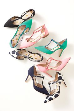 In brights, prints or go-with-everything neutrals, these pointed pumps are a pair you'll wear all year. The open T-bar shape is comfortable for running errands, but there's plenty of style for cocktail hour. Contrast grosgrain piping and a ribbon up the back make them a perfect partner for your LBD.