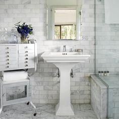 Bringing grey into the bathroom in the tiles. Don't like the pedestal basin nor the drawers and cupboards.
