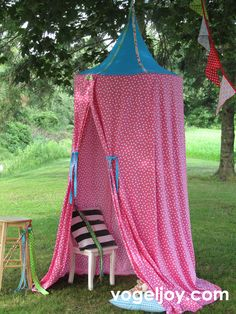 A portable reading and play space & shade for the yard!!! A hula hoop, salvaged curtains, ribbon & a tree branch. Perfect!
