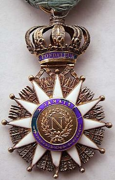 Order of the Reunion.  Intended to replace a wide range of orders in the Netherlands and Germany, it was only issued for some 5 years before becoming obselete. There were around 1,400 awards made in 3 classes, of which this is an example of the Knights award. Some one third of the awards were to Frenchmen, and the majority were to Dutch citizens. With the first abdication of Napoleon it was no longer permitted to wear the badge itself, but the ribbon or sash could be worn.