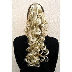 Wunderschönes Haarteil aus hochwertiger japanischer Kunstfaser. Eine stabile Klammer/Clip, die im eigenen Haar befestigt wird, verleiht dem Haarteil einen sicheren Halt.