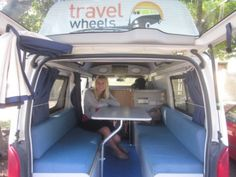 Photo of a girl in the back of a campervan for sale