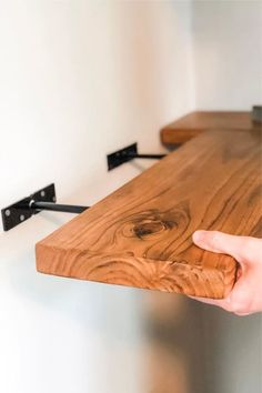 Want a quick and easy way to add more storage and spice up that old room at the same time? Check out the best floating shelf ideas and tutorials for inspiration to get started! Wooden Floating Shelves, Wood Shelves, Floating Shelf With Brackets, Building Floating Shelves, Floating Bedside Shelf, Wooden Shelf Brackets, Tv Shelving, Wooden Shelves Kitchen, Unique Wall Shelves