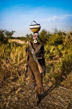 Warrior, Mursi by Dmitri Markine, via 500px.
