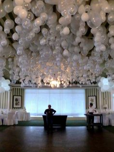 DIY for a Fairy Tale Setting for a Wedding. Get lots of friends to help blow up balloons and then hang them upside down (on Pinterest someone suggested putting a marble inside each one). Damage to ceiling - unknown. Oiginal souce:Wedding Ceiling at the Port Royal Club, Naples FL byBayside Balloons Private Events here(link gone). They still have a FB page and you can check them out here. Here is a photo of them setting up the event.
