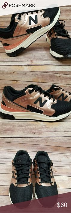 New Balance 7.5 Revlite 1550 Runner Running Shoes Nearly new women's 7.5 New Balance Revlite 1550 running shoes. Worn so little there's no toe creasing. Beautiful and rare black and metallic rose gold theme. Amazing shoes!   From a smoke free home! New Balance Shoes Athletic Shoes