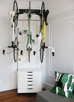 Simple and economical home bike storage. Delta racks + an IKEA storage unit. Hanging Bike Rack, Indoor Bike Rack, Indoor Bike Storage, Bike Hooks, Bike Storage Ikea, Bike Storage Apartment, Bicycle Storage, Diy Bike, Bike Storage Solutions