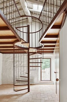 An elegant, minimalist stair and guardrail design of wood and steel for a rehabilitated Spanish farmhouse. By Architecture-G.