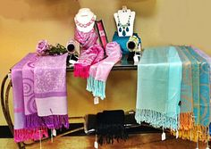 Pashmina Scarves in colors ranging from Purple to Pink to Teal and Blue with matching jewelry.  Update your wardrobe with this Spring collection.