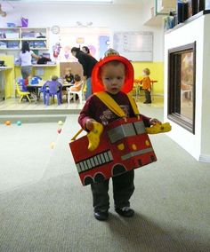 Toddler Fire Truck costume  Looks like a simple box with straps (clip on) and painted image. Too cute. I bet the local fire department has badge stickers to go with it :)