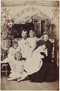 Portrait of the Romanov family. Tsar Nicholas and Alexandra, and four of their children. After the February Revolution, Nicholas II and his family were placed under house arrest in the Alexander Palace. On July 17, 1918, Bolshevik authorities, led by Yakov Yurovsky, shot Nicholas II, his immediate family, and four servants in the cellar of the Ipatiev House in Yekaterinburg, Russia.