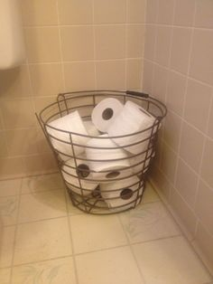 Toilet paper in rustic metal basket