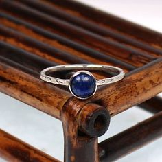 [Lapis lazuli ring with textured band. $18.00, via Etsy.]