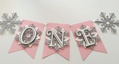 Snowflake Highchair Banner!  Its time for a Onederland First Birthday Party! Attach this banner to the Highchair to help create the perfect picture moments!  DETAILS: - ONE with Snowflakes - Light Blue, White, and Silver Glitter -Strung on white silk ribbon - Each pennant is around 5 Tall This banner can come in other color ways, message us with what you are looking for! This item will be shipped two day priority mail.
