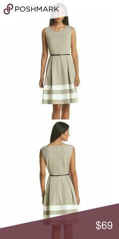 Calvin Klein Belted Ponte Flare Striped-hem Dress New with Tags - Calvin Klein Belted Fit and Flare Ponte Knit Striped-hem Dress  Keep it classic in this fit and flare ponte knit dress by Calvin Klein. Dual stripes near the hem add some modern flair.  Color: Khaki/Ivory  Crew neck. Sleeveless Hidden back zip closure Detachable belt at waist Inverted pleats on skirt Two stripes near hem Dry Clean Polyester/Elastane Calvin Klein Dresses