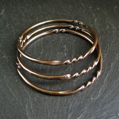 tutorial for Copper Bangles - round wire was first flattened in e places, then twisted