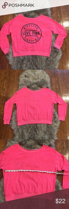 VS Pink Reversible Sweatshirt Very cute, bright sweatshirt! This sweatshirt is reversible so you get 2 styles depending on your mood. One side is terry cloth, front is blank with large PINK emblem encircled on back. Other side is normal sweatshirt material, back is blank with a smaller PINK emblem on the front. There is one faint stain on terry cloth side, on the back underneath emblem. Measurements included since there is no tag- I believe this was a small which is my normal size for PINK…