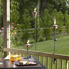 Fill these gorgeous copper torches with citronella fuel to relax and enjoy the final days of summer.