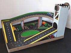 Toy Car Play Mat with Lift and Parking ♡ Cardboard play mat fits Ikea Latt table Tutorial: Toddler Play Table, Diy Toys Car, Toy Diy, Cardboard Play, Cardboard Storage, Cardboard Race Track, Cardboard Crafts Kids, Car Play Mats, Diy Karton