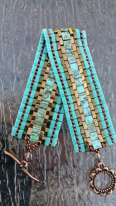 Check out this item in my Etsy shop https://www.etsy.com/listing/231861607/gorgeous-turquoise-tila-and-half-tila