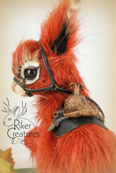 A Fire Squirrel from etsy Sop name Rikercreatures