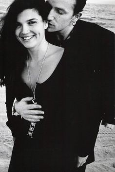 "Bono and Ali. Alison ""Ali"" Hewson is an Irish activist and business woman. She is the wife of singer and musician paul Hewson, known as Bono, from the rock group U2.@"