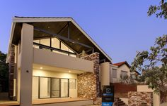 Housing design, Classic cream render, possum matte glosswood, recycled red brick wall with charcoal grey mortar