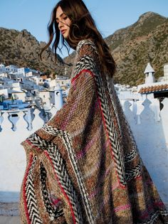 Heart of Glass Cape | Hand knit gorgeous and luxe space dyed cape pieced with different colors and patterns that all complement each other perfectly. Made from hand-spun and hand-dyed super soft alpaca yarn, this heavyweight knit is the perfect cold weather must-have. Adjustable ties.