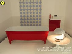 Official photo of #FuoriSalone with cherry red Accademia #bathtub and #red Milestone #washbasin in a very artistic setting #bathroom