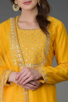 From our Indian Spring Collection, this Sunglow Yellow farshi palazzo suit is adorned with beautiful pearl beads, gota patti, sequin, zari and zardozi hand embroidery. The kurta and farshi ( wide leg palazzo pants) are crafted in chanderi and the Embroidery Suits Punjabi, Kurti Embroidery Design, Hand Embroidery Dress, Zardozi Embroidery, Embroidery Ideas, Kurta Designs Women, Kurti Neck Designs, Blouse Designs, Dress Designs