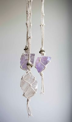 A long hanging quartz crystal bound in a secure macrame net of organic hemp. This is a super strong, ethical and sustainable piece of jewellery