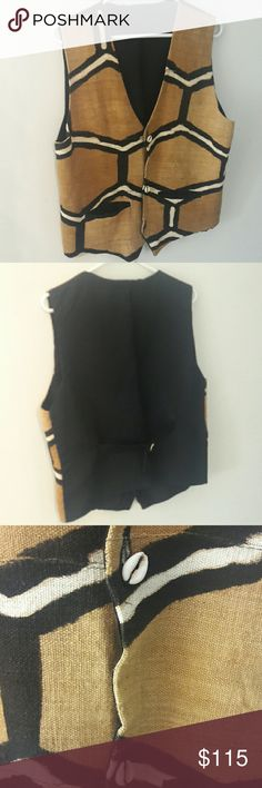 African Mudcloth Vest This awesome African mudcloth vest is an authentic classic. It is a medium to large size with an adjustable strap in back. great, gently condition. Unknown Jackets & Coats Vests