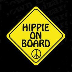 """yellow Yield Sign with black words that say """"HIPPIE ON BOARD""""  and there is a small plain black peace sign at the bottom"""