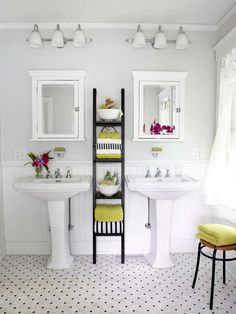 Dual Storage   Put wasted space between vanities to work with a shelving unit. A ladder placed between the sinks makes use of potentially wasted space and holds towels, washcloths, and other bathroom essentials. Two medicine cabinets above the twin pedestal sinks store toothpaste, mouthwash, and medicine, while wall-mount soap holders below keep hand soap within easy reach.