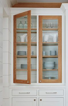 Add stained oak door frames to white kitchen cabinets to create a rustic cottage contrast for white shaker cabinet doors and surrounding shiplap walls. Oak Door Frames, Oak Doors, White Shaker Cabinet Doors, Farmhouse Interior, Coastal Farmhouse, Farmhouse Bathrooms, Black Interior Doors, Beach House Decor, Home Decor