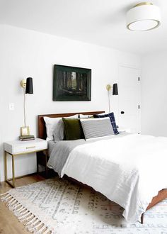A minimal masculine master bedroom with linen, brass, deep green, plaid and navy. #thefauxhouse