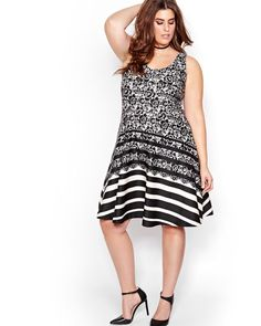 Slip into this plus size dress for a festive look that's easy to wear but gorgeous. Features a romantic lace print paired with an edgy stripes. The fit and flare shapeis perfect for shaped, slim, and curvy silhouettes. Sleeveless, round neckline, exposed zipper at the back, Michel Studio, 40 inch length.