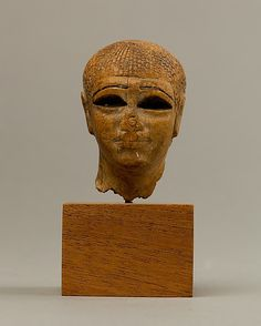 Head of a female figure from the tomb of Khety. Period: Middle Kingdom. Dynasty 11. Reign of Mentuhotep II. Date: ca. 2051–2000 B.C. Upper Egypt; Thebes, Deir el-Bahri, Tomb of Khety.
