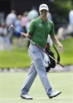 Adam Scott, of Australia, smiles as he walks from the fifth green during a practice round for the PGA Championship golf tournament at Oak Hill Country Club, Tuesday, Aug. 6, 2013, in Pittsford, N.Y.