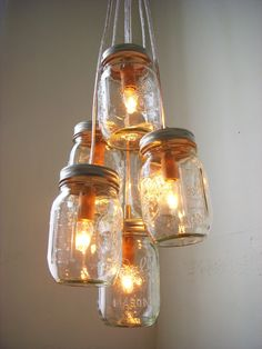 Summer's Glow  Mason Jar Chandelier Lighting Fixture by BootsNGus, $130.00  Or you could just make it yourself for way less money.
