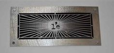 We were commisioned to replace the standard  Air Conditioning Grills with L'entranger logo, surrounded by the original French book cover of L'etranger London SW7 4QT