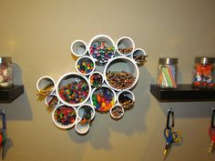PVC pipes cut, painted and organized into an artsy pattern make a great way to organize art supplies.