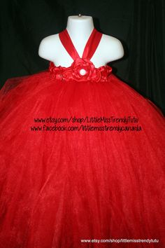 Listing is for a Red Tutu Dress Red tutu dress made with red tulle and hand made flowers. Tube top stretches to fit a 28 inch chest. All of my dresses are 3 layers of tulle, for maximum fullness and fluff! There is NO slip under this dress in the pictures. This Tutu Dress is