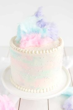 Cotton Candy Cake angled picture showing watercolor sides, pearl border, and cotton candy on top.
