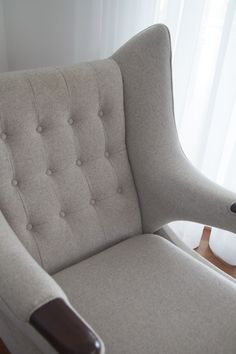A vintage-inspired upholstered armchair.