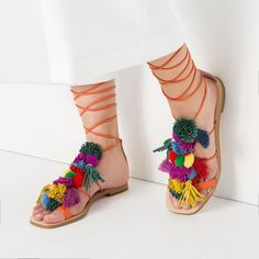 FRINGED FLAT LEATHER SANDALS ($90) ❤ liked on Polyvore featuring shoes, sandals, pom pom sandals, pom pom shoes, genuine leather shoes, real leather shoes and leather shoes