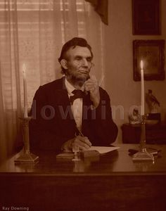 Abraham Lincoln at his desk. Where did all these unfamiliar pictures of Lincoln come from? You usually see only the same two or three. Abraham Lincoln Pictures, Abraham Lincoln Family, Mary Todd Lincoln, American Revolutionary War, American Civil War, American Presidents, Us Presidents, Us History, Black History